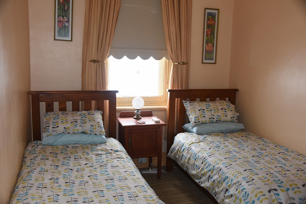 Twin bedded room upstairs